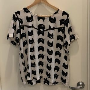 Black and white cat top